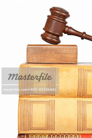 Wooden gavel from the court and law books isolated on white background. Shallow depth of field Stock Photo - Budget Royalty-Free, Image code: 400-05136441