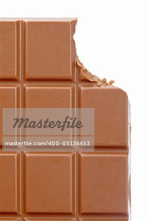 Bitten chocolate bar isolated on white background. Shallow depth of field Stock Photo - Budget Royalty-Free, Image code: 400-05136453