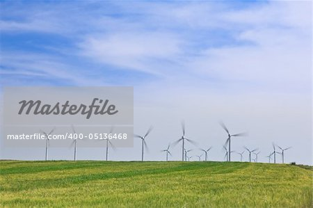 Wind turbines farm in green field over cloudy sky Stock Photo - Budget Royalty-Free, Image code: 400-05136468