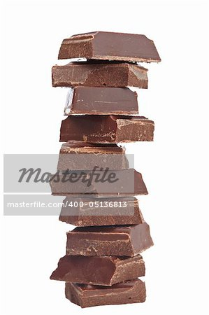 Blocks of chocolate isolated on white background. Shallow depth of field Stock Photo - Budget Royalty-Free, Image code: 400-05136813