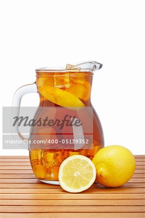 Ice tea pitcher with lemon and icecubes on wooden background Stock Photo - Budget Royalty-Free, Image code: 400-05139352