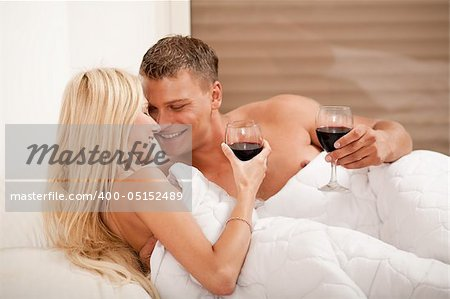 Young couple celebrating with champagne Stock Photo - Budget Royalty-Free, Image code: 400-05152489