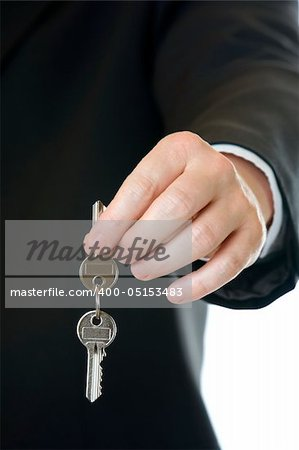 One businessman gives another businessman a key