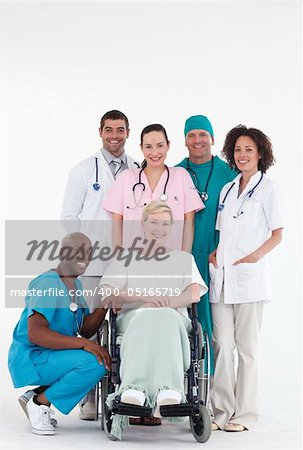 Group of doctors with a patient in a wheel chair Stock Photo - Budget Royalty-Free, Image code: 400-05165719