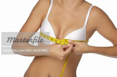 Caucasian woman measuring her bust on a white background Stock Photo - Budget Royalty-Free, Image code: 400-05167883