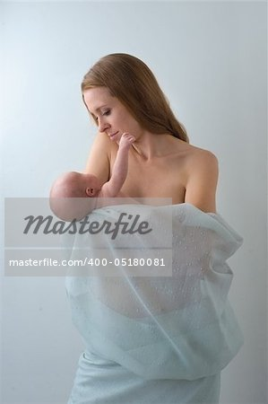 Mother holding a young baby. Stock Photo - Budget Royalty-Free, Image code: 400-05180081