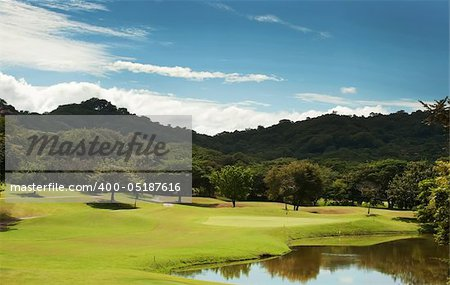 Image of a beautiful golf course fairway at a tropical resort Stock Photo - Budget Royalty-Free, Image code: 400-05187616