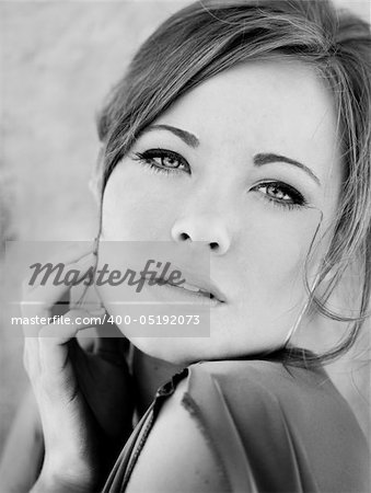 Image of a gorgeous woman with hand on her face Stock Photo - Budget Royalty-Free, Image code: 400-05192073