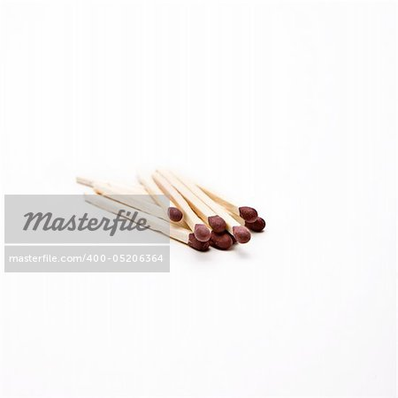 Matches unlit on a white surface Stock Photo - Budget Royalty-Free, Image code: 400-05206364