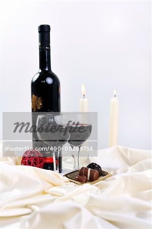 luxury and sweet praline and chocolate with wine bottle and glasses  decoration Stock Photo - Budget Royalty-Free, Image code: 400-05209714