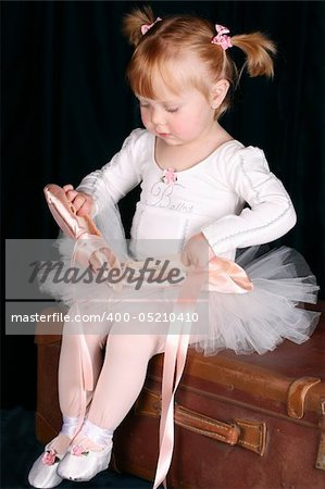 Little ballet toddler wearing a white tutu Stock Photo - Budget Royalty-Free, Image code: 400-05210410