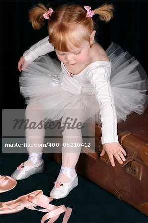 Little ballet toddler wearing a white tutu Stock Photo - Budget Royalty-Free, Image code: 400-05210412