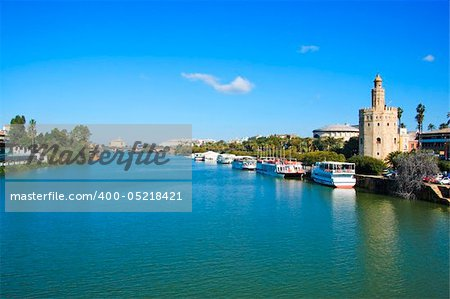 A view of the Guadalquivir River and the Torre del Oro, in Seville, Spain Stock Photo - Budget Royalty-Free, Image code: 400-05218421