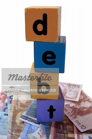 assorted childrens toy letter building blocks against a white background on money that spell debt Stock Photo - Budget Royalty-Free, Image code: 400-05241315