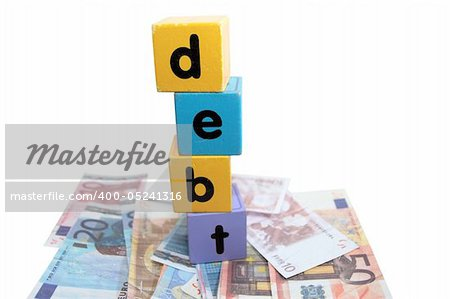 assorted childrens toy letter building blocks against a white background on money that spell debt Stock Photo - Budget Royalty-Free, Image code: 400-05241316