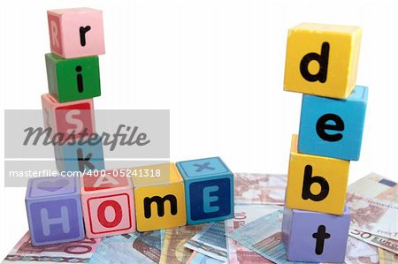 assorted childrens toy letter building blocks against a white background on money that spell home debt risk Stock Photo - Budget Royalty-Free, Image code: 400-05241318