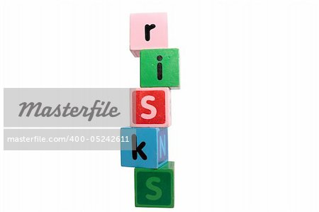 risks spelt with childrens toy letter building blocks against a white background with clipping path Stock Photo - Budget Royalty-Free, Image code: 400-05242611