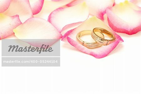 Wedding rings on a red rose petal Stock Photo - Budget Royalty-Free, Image code: 400-05244104