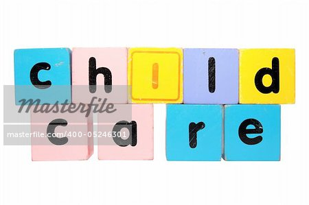 assorted childrens toy letter building blocks against a white background that spell childcare with clipping path Stock Photo - Budget Royalty-Free, Image code: 400-05246301