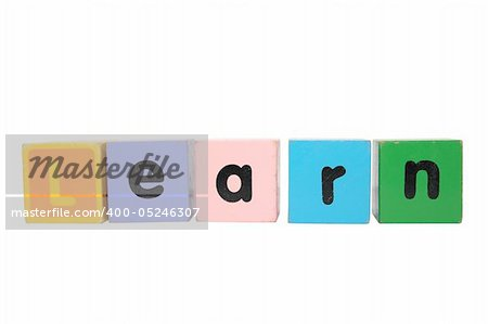 assorted childrens toy letter building blocks against a white background that spell learn with clipping path Stock Photo - Budget Royalty-Free, Image code: 400-05246307