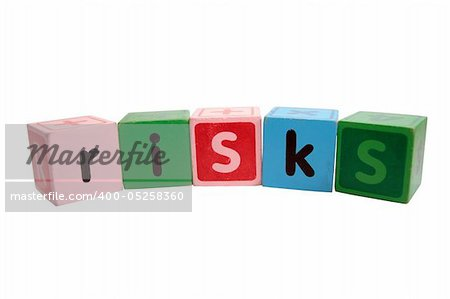 assorted childrens toy letter building blocks against a white background that spell risks with clipping path Stock Photo - Budget Royalty-Free, Image code: 400-05258360