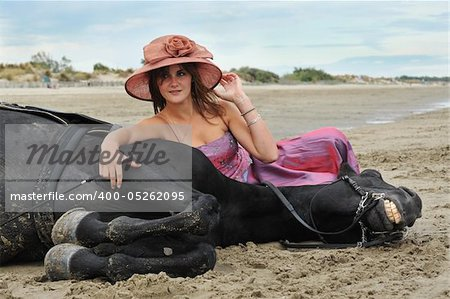 beautiful black stallion on the beach with young woman Stock Photo - Budget Royalty-Free, Image code: 400-05262095