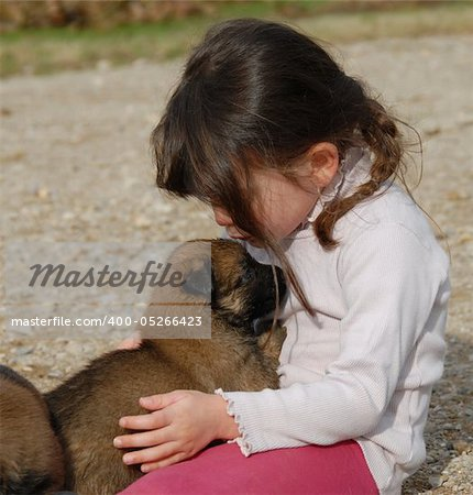 a little girl kissing her baby purebred belgian shepherd Stock Photo - Budget Royalty-Free, Image code: 400-05266423