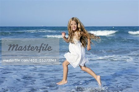 Little girl running beach shore splashing water in blue sea Stock Photo - Budget Royalty-Free, Image code: 400-05273743