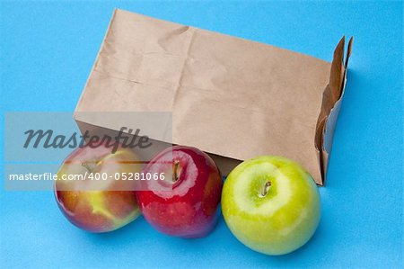 Healthy School Lunch Themed Image with Apples and a Brown Bag. Stock Photo - Budget Royalty-Free, Image code: 400-05281066