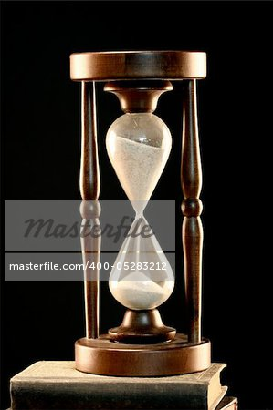 Hourglass close up over black Stock Photo - Budget Royalty-Free, Image code: 400-05283212