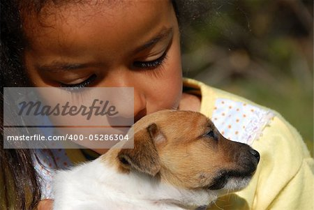little girl and her very young puppy jack russel terrier Stock Photo - Budget Royalty-Free, Image code: 400-05286304