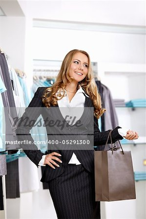 The young attractive girl with a bag in shop Stock Photo - Budget Royalty-Free, Image code: 400-05291300
