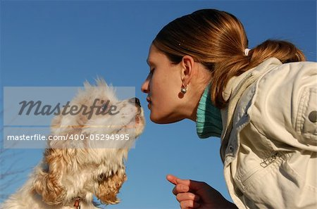 young purebred american cocker kissing his young owner girl Stock Photo - Budget Royalty-Free, Image code: 400-05294995