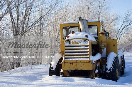 Snow covered tractor abandoned Stock Photo - Budget Royalty-Free, Image code: 400-05306872