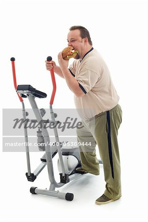 Overweight man eating a large hamburger standing by an exercising device - fittness fail concept isolated Stock Photo - Budget Royalty-Free, Image code: 400-05309444