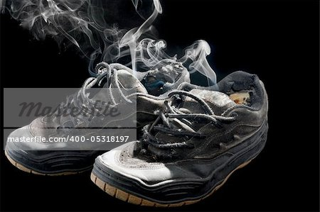 pair of smelly old sneakers on a black background Stock Photo - Budget Royalty-Free, Image code: 400-05318197