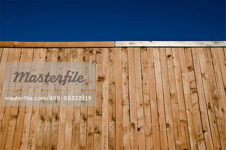Image of a wooden fence shot from a low angle looking slightly up with blue sky Stock Photo - Budget Royalty-Free, Image code: 400-05322119