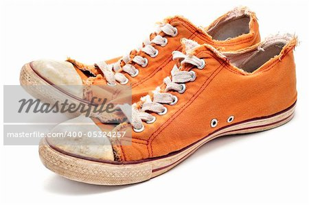 a pair of worn sneakers on a white background Stock Photo - Budget Royalty-Free, Image code: 400-05324257