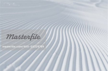 tracks on ski slopes in snow at beautiful sunny  winter day with blue sky Stock Photo - Budget Royalty-Free, Image code: 400-05328789