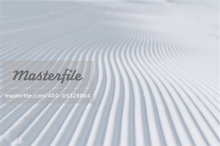 tracks on ski slopes in snow at beautiful sunny  winter day with blue sky Stock Photo - Budget Royalty-Free, Image code: 400-05328804