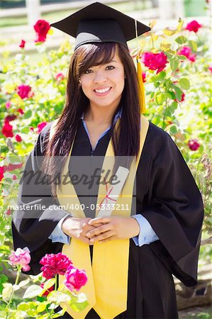 Stock image of happy female graduate, outdoor setting, Stock Photo - Budget Royalty-Free, Image code: 400-05333211