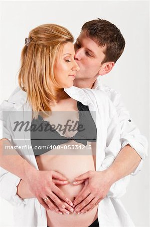 man and his pregnant wife are embracing. Stock Photo - Budget Royalty-Free, Image code: 400-05334215