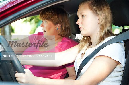 Teenage driver and her mother about to have a car accident. Stock Photo - Budget Royalty-Free, Image code: 400-05347529