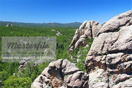Rock formations scatter the pine forests of Black Hills National Forest in South Dakota. Stock Photo - Budget Royalty-Free, Image code: 400-05354862