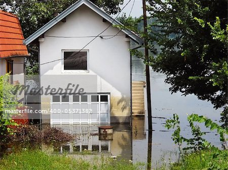 house surrounded by water in river during spring flood in Serbia Stock Photo - Budget Royalty-Free, Image code: 400-05371382