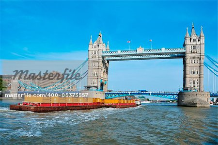 A cargo ship in front of Tower Bridge in London, United Kingdom