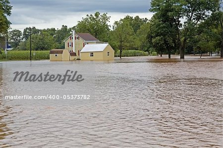 Rising water from the Middle Creek floods a house in Clay,Pennsylvania. Stock Photo - Budget Royalty-Free, Image code: 400-05373782
