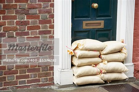 Sandbags Stacked In A Doorway In Preparation For Flooding Stock Photo - Budget Royalty-Free, Image code: 400-05374282