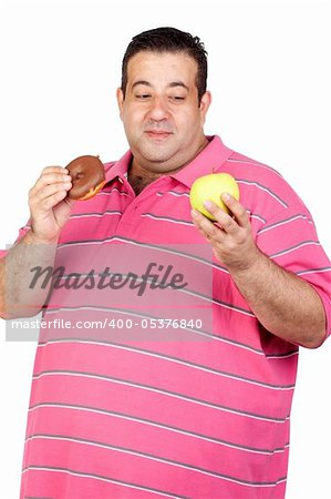 Fat man deciding between a candy and an apple isolated on white background Stock Photo - Budget Royalty-Free, Image code: 400-05376840