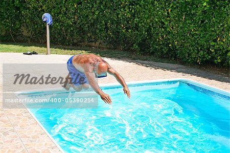 Man jumoing to swimming pool. Stock Photo - Budget Royalty-Free, Image code: 400-05380214